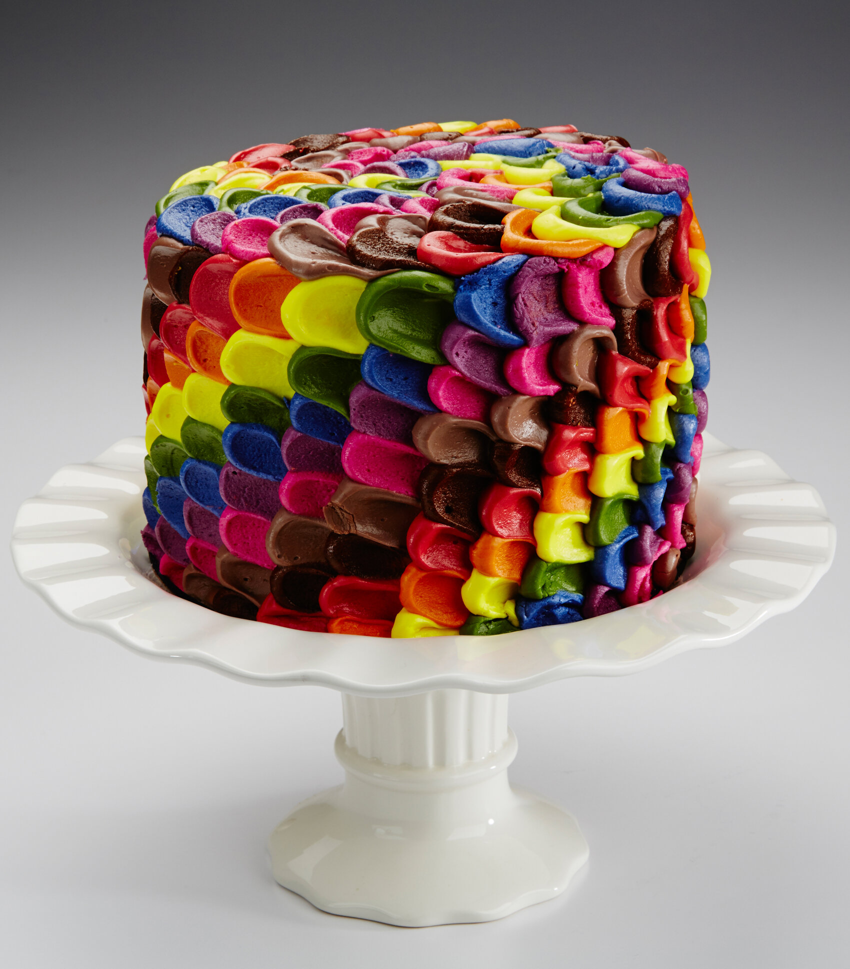This multi-colored cake's icing is made from red cabbage juice, turmeric, annatto, beet juice, and caramel color. (Courtesy of colorMaker Inc.)