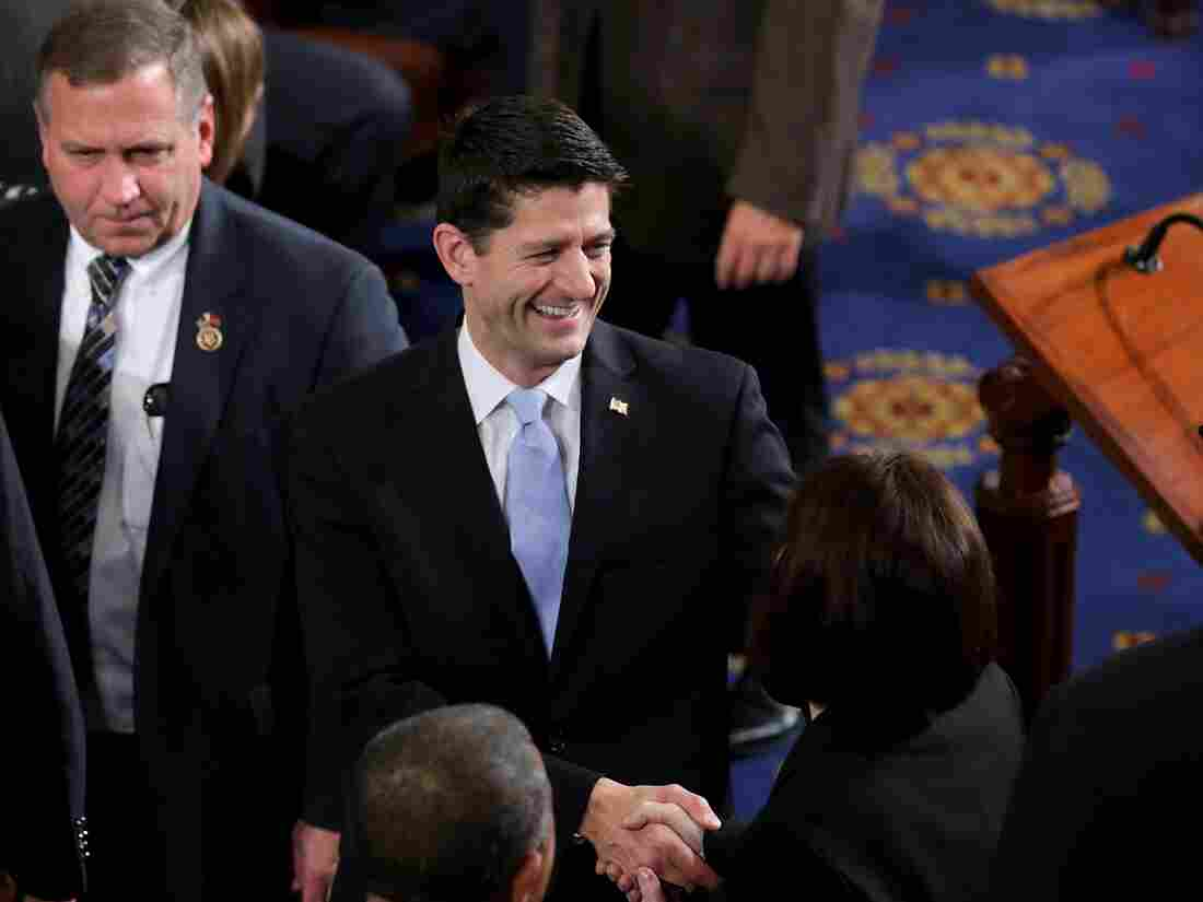 Newly elected Speaker Paul Ryan, R-Wis., greets fellow members on the floor of the House chamber.