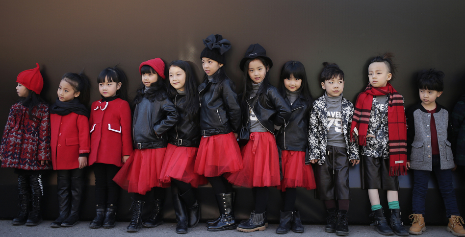 Models for children's wear wait for a show during China Fashion Week in Beijing on Thursday. China announced an end to the one-child policy for urban couples that had been place for more than three decades. (Andy Wong/AP)