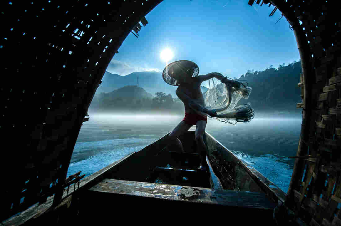 Second place: Fishermen in China set out early in the morning with their nets.