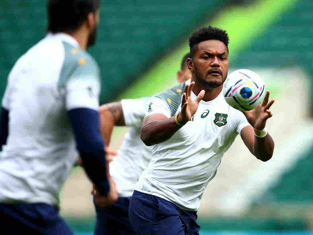 Henry Speight of Australia receives a pass during the Wallabies' practice ahead of Saturday's World Cup final against New Zealand at Twickenham Stadium in London.