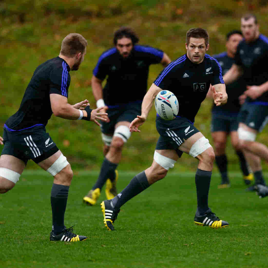 Richie McCaw of the All Blacks passes during a New Zealand training session on Friday in preparation for the World Cup final on Saturday.