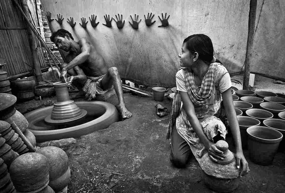 Third place: A teenage girl helps her father in their pottery business in West Bengal, India.