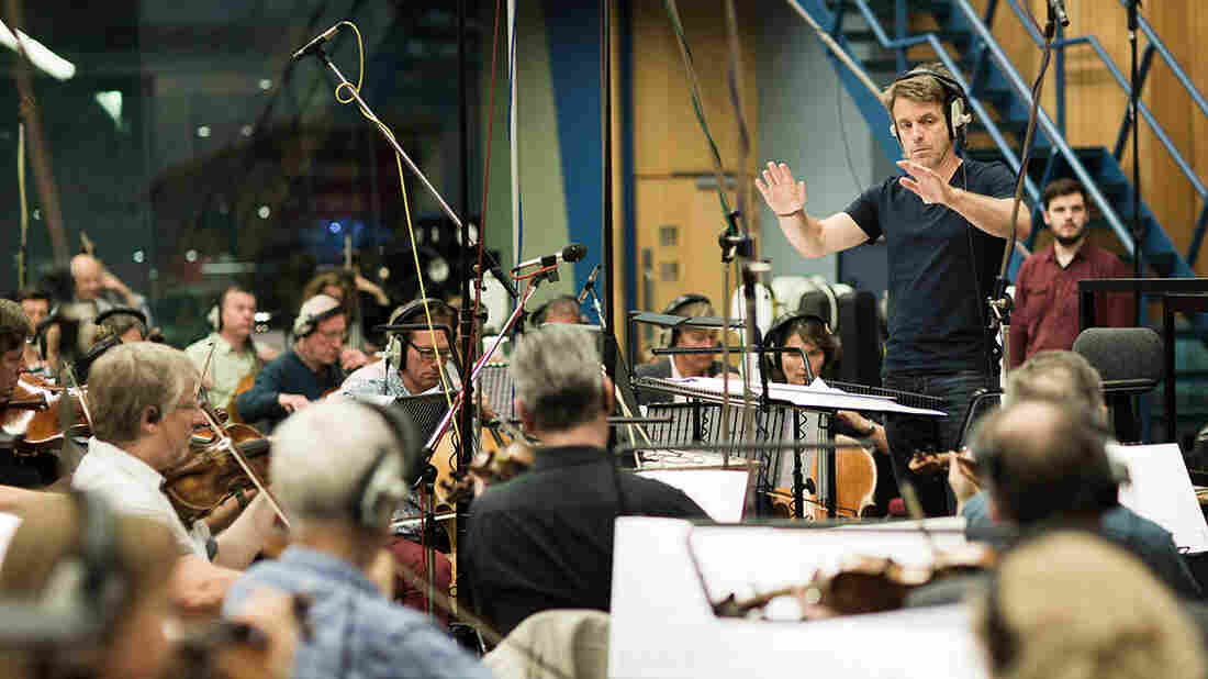 Harry Gregson-Williams leads musicians at a scoring session for The Martian.