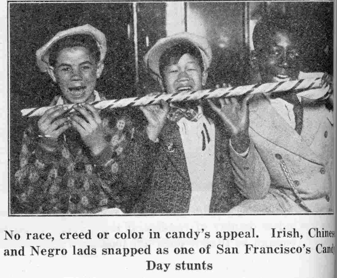 """An ad of the era features a trio of """"Irish, Chinese and Negro lads"""" chomping on a long peppermint cane. The image was a direct reference to pictures of barefoot black and Caribbean children sucking on sugarcane, which were common in the 1900s."""