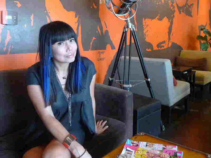 Lynda Trang Dai sits inside her restaurant, Lynda Sandwich, in Orange County, Calif.