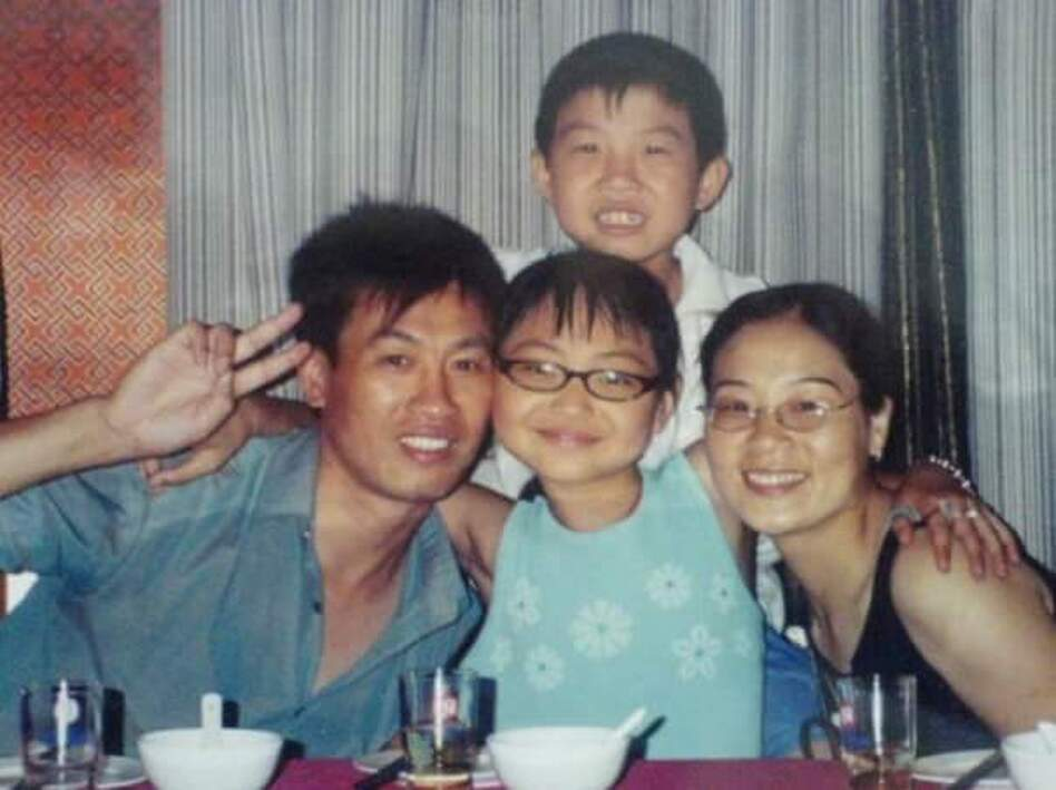 In 2005, when she was 12 years old, Ricki Mudd (center) traveled to China to meet her birth father Wu Jin Cai, birth brother Wu Chao and birth mother Xu Xian Zhen. Mudd had been given up for adoption after Wu Chao was born; her family wanted a son, and her parents were limited to one child. (Courtesy of Ricky Mudd)