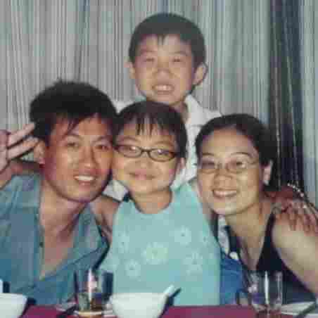 In 2005, when she was 12 years old, Ricki Mudd (center) traveled to China to meet her birth father Wu Jin Cai, birth brother Wu Chao and birth mother Xu Xian Zhen. Mudd had been given up for adoption after Wu Chao was born; her family wanted a son, and her parents were limited to one child.