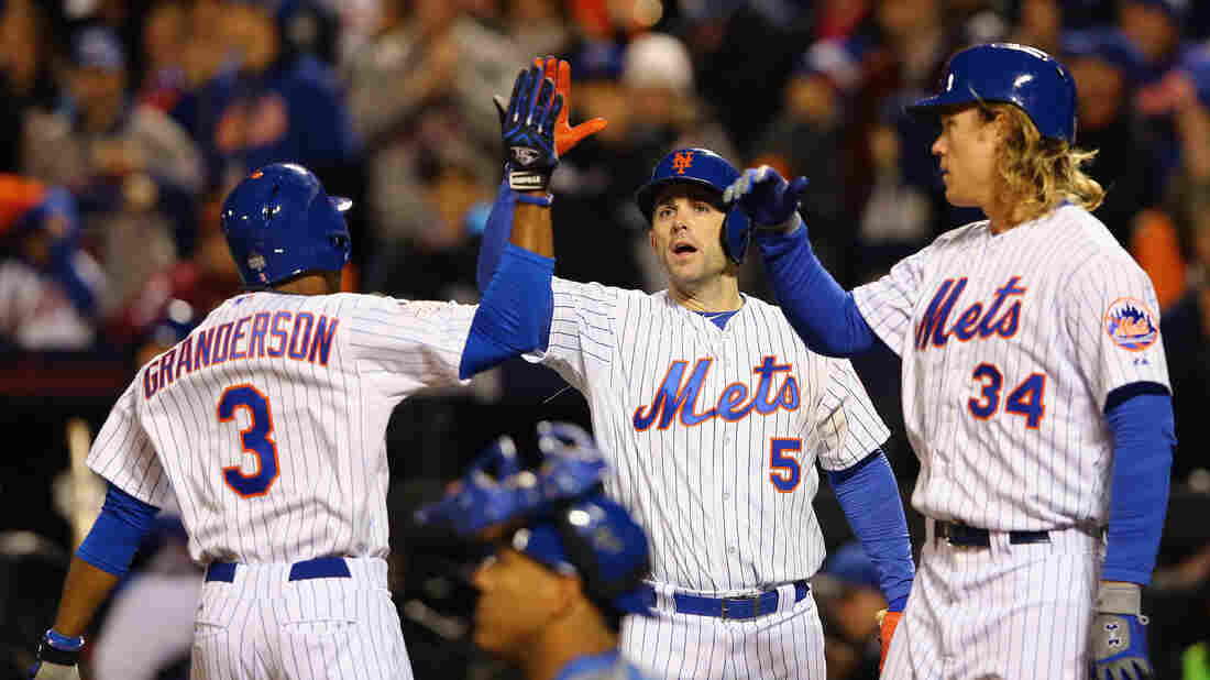 Curtis Granderson of the New York Mets celebrates with Noah Syndergaard and David Wright after hitting a two-run home run in the third inning against Kansas City. The hit put pitcher Syndergaard across home plate after he hit a single in his first World Series at-bat.