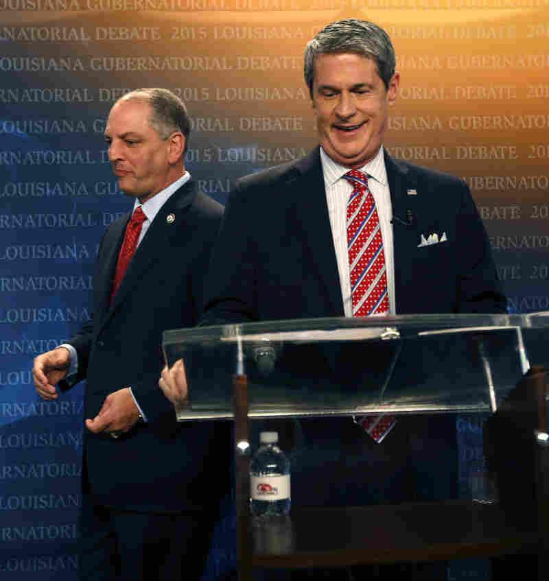 Democratic state Rep. John Bel Edwards, left, walks past U.S. Sen. David Vitter, R-La., as they take their places before a debate.