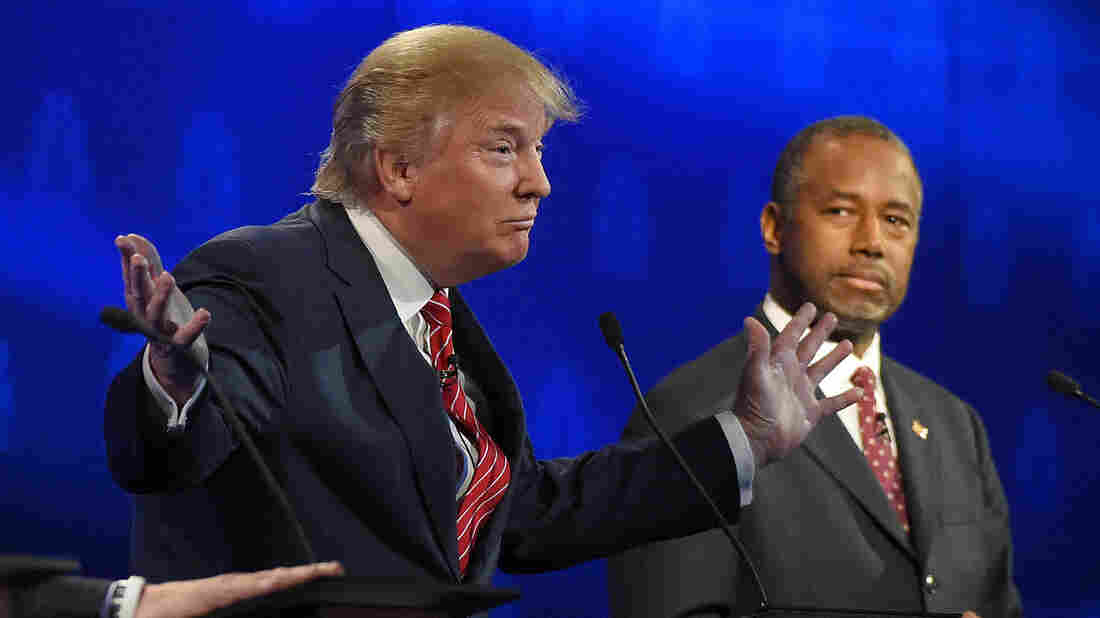 Donald Trump speaks during the CNBC Republican presidential debate Wednesday as Ben Carson looks on. The GOP candidates are pushing for changes to the debate formats.