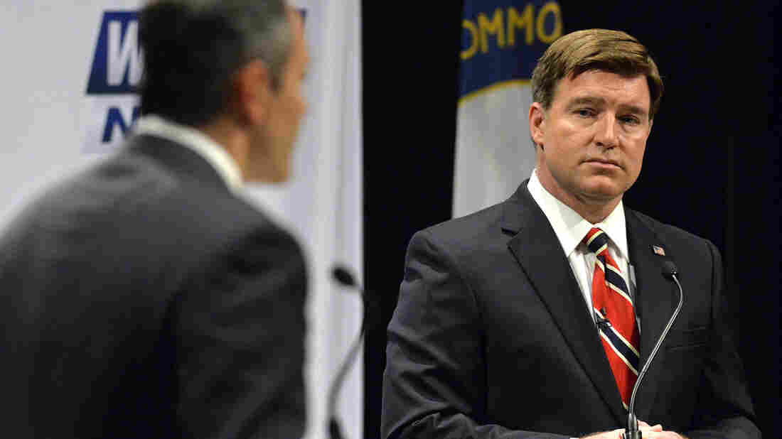 Kentucky Democratic gubernatorial candidate Jack Conway, right, listens to the reply of Republican candidate Matt Bevin during a debate.