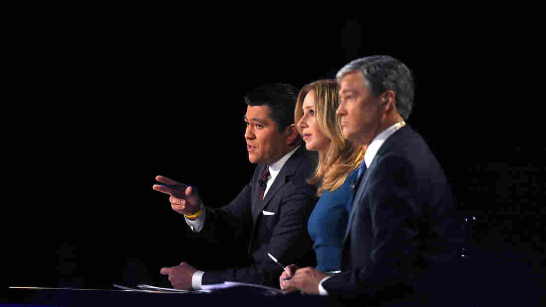 """Debate moderators Carl Quintanilla (from left), Becky Quick and John Harwood appear during the CNBC Republican presidential debate on Oct. 28. Most Republican candidates agreed on at least one thing following the debate: """"Gotcha"""" questions have got to go."""