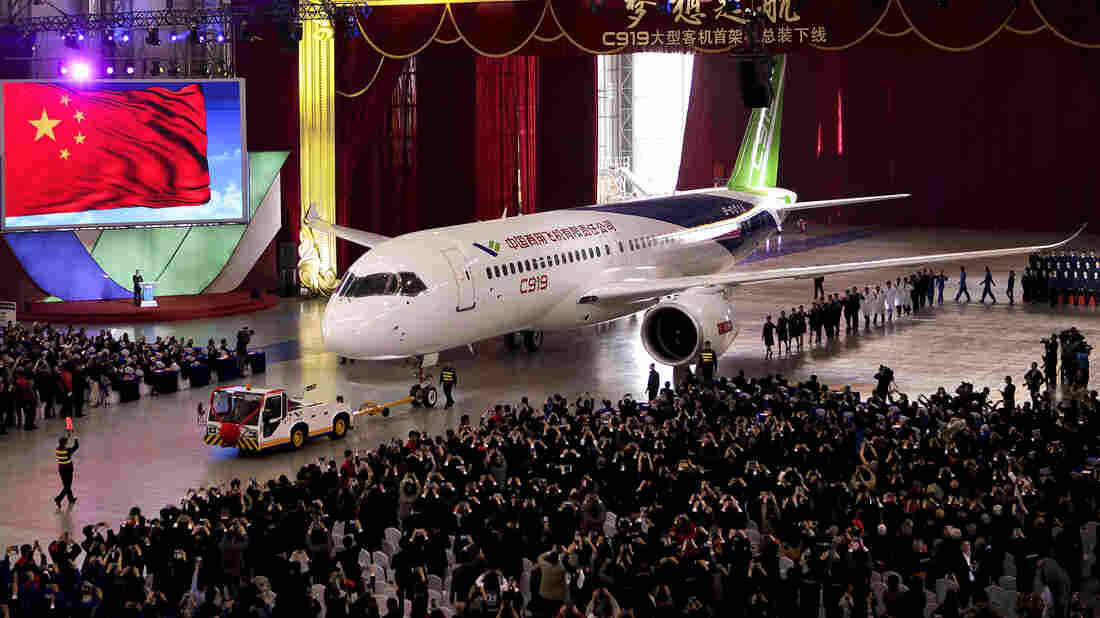 The first twin-engine C919 passenger plane made by the Commercial Aircraft Corporation of China is pulled out of the company's hangar Monday during a ceremony near Shanghai.
