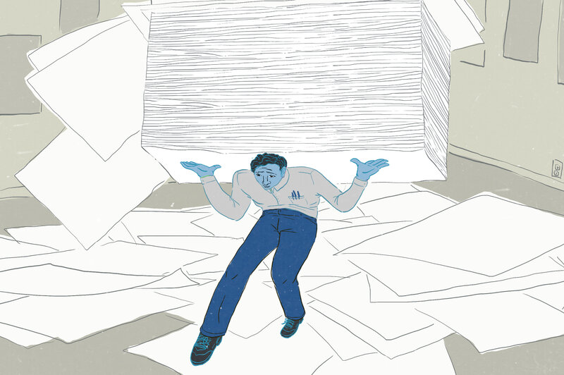 Man carrying huge stack of papers and papers strewn about. (LA Johnson/NPR)
