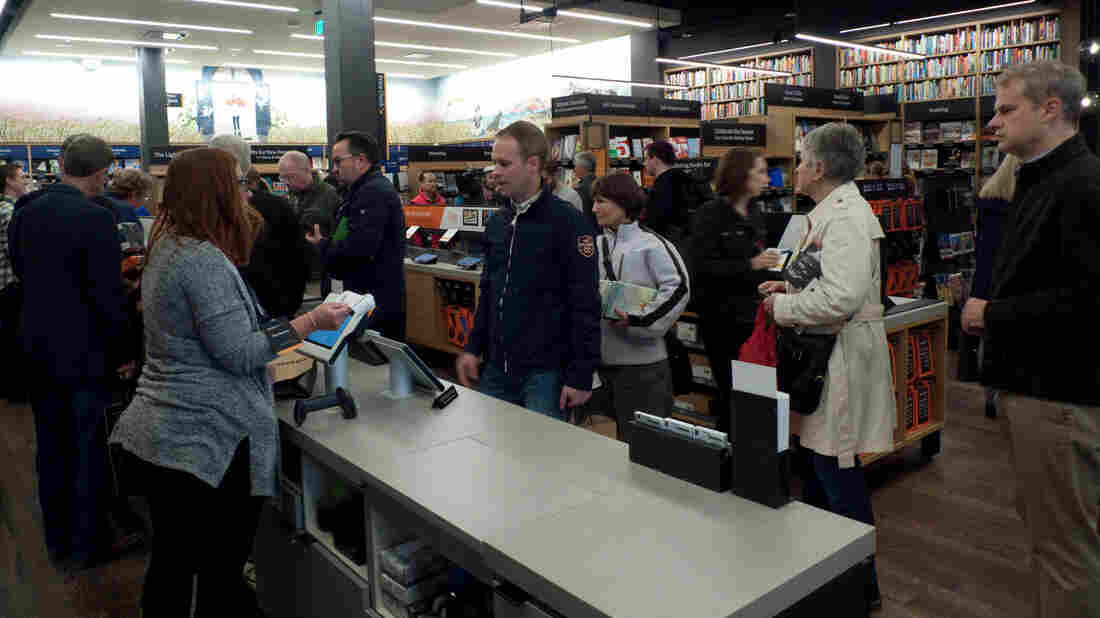 Proceed to checkout: At its new bookstore, Amazon's customers lined up to buy books in Seattle Tuesday.