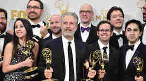 Jon Stewart, seen here with his Daily Show team at the recent Emmy Awards show, will create digital content for HBO, under a new exclusive four-year deal.