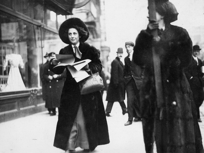 Martha Gruening, a suffragist leader, distributes literature on the movement to passersby in New York City, circa 1912. She later earned a law degree from New York University and was active in the civil rights movement.
