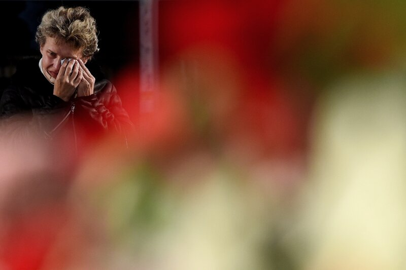 A woman mourns at a makeshift memorial for the victims of a jetliner crash outside Pulkovo International Airport in St. Petersburg on Tuesday.