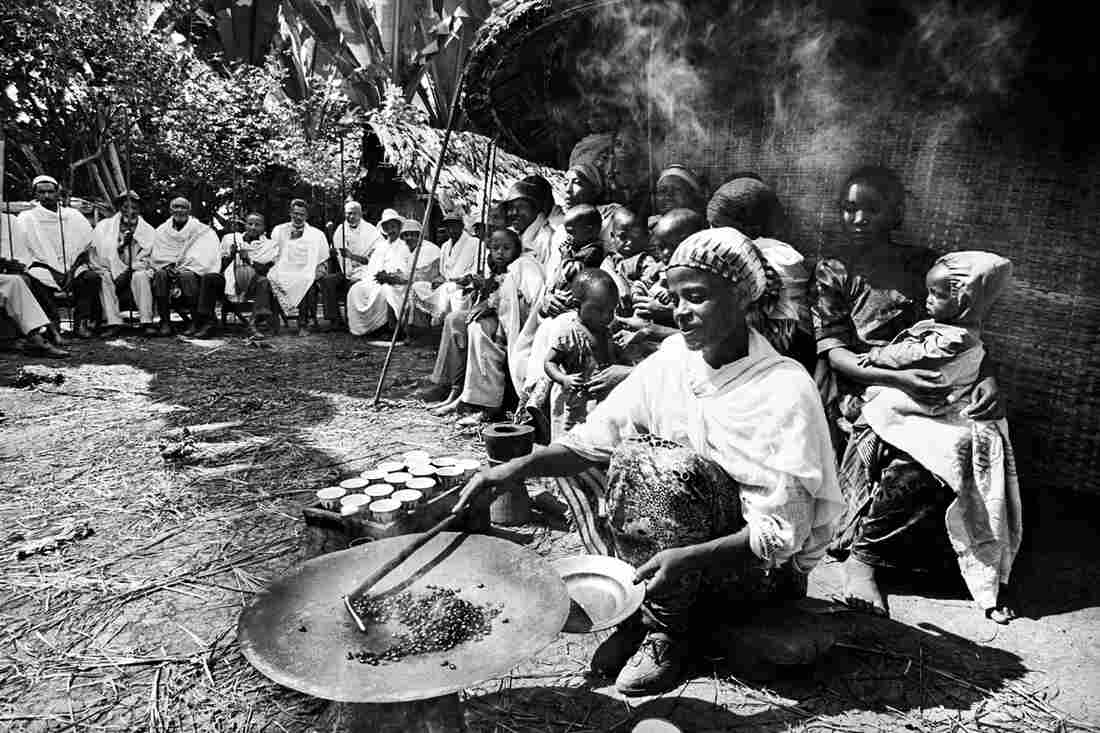 Villagers performing a coffee ceremony during coffee-picking season in Ethiopia.