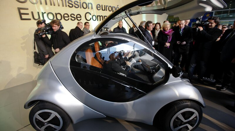 """There was a lot of excitement in 2012, when the Hiriko car was unveiled at this event at European Union headquarters in Brussels. At the time, the then-president of the European Commission, Jose Manuel Barroso, hailed the car as a trans-Atlantic """"exchange between the world of science and the world of business."""" (Zhou Lei/Xinhua/Landov)"""
