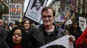 """Director Quentin Tarantino attends a march to denounce police brutality in New York City on Oct. 24. At the rally, Tarantino said, """"I have to call the murdered the murdered, and I have to call the murderers the murderers"""" — drawing considerable backlash from police unions."""