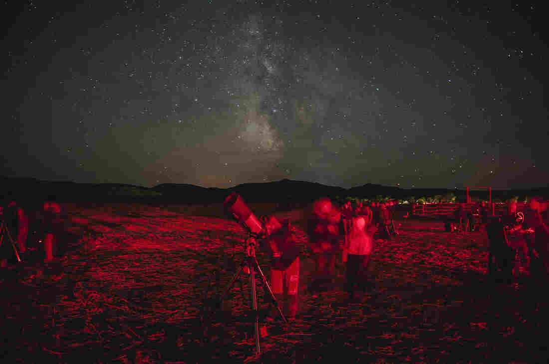 Star gazers flock to the south unit of Theodore Roosevelt National Park in western North Dakota for the annual Dakota Nights Astronomy Festival. Red lights were used during the event to help people move between telescopes without ruining their night vision. Between 2010 and 2013, the amount of non-natural light visible from the park increased by 500 percent, more than in any other national park.