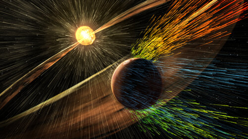 Solar storms from the sun send charged particles streaming towards Mars. Research now shows those particles are stripping away the atmosphere. (NASA/GSFC)