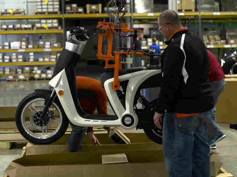 Workers at Mahindra's Ann Arbor, Mich., factory load up a new GenZe for shipping to the initial markets of the San Francisco Bay Area and Portland, Ore.