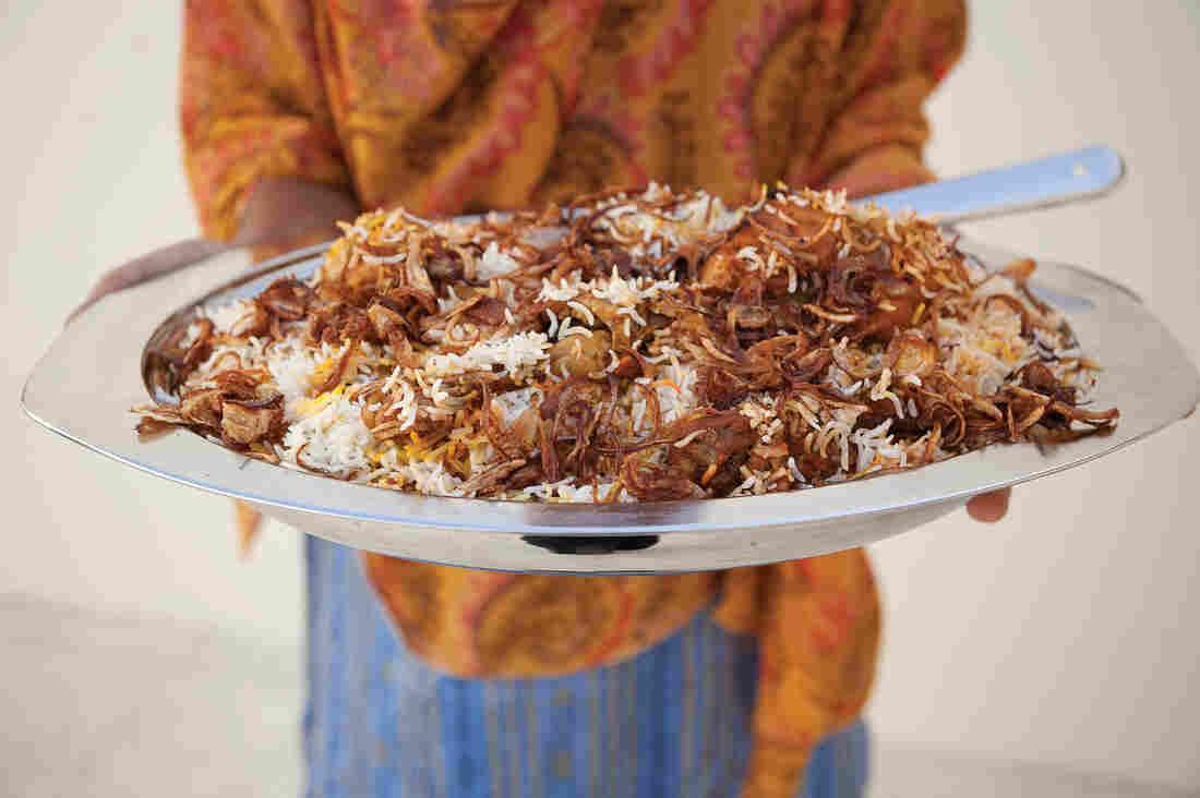 Zanzibari biryanai, a dish involving spiced poached chicken, fried onions, a rich gravy and rosewater- and saffron-scented rice. Zanzibar was part of Oman until 1965.