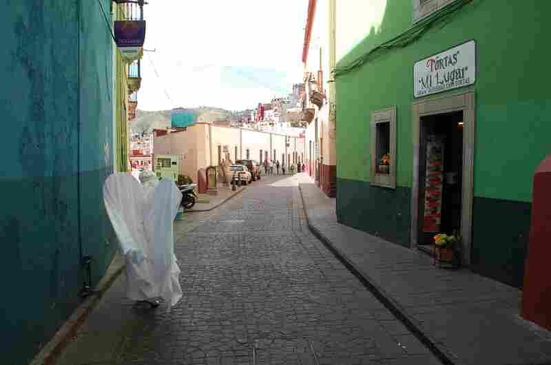 An angel walks the streets of Guanajuato.