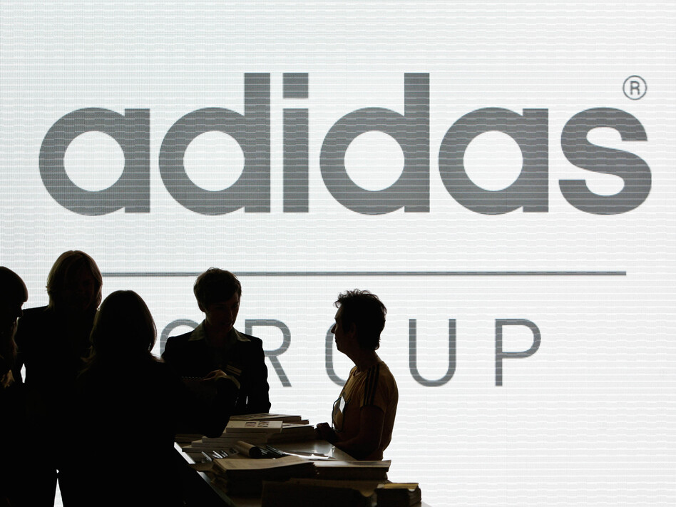 Adidas has pledged to help high school teams that want to change their mascots from Native American imagery. President Obama praised the effort, while the Washington football team shot back, calling the company's move hypocritical. (Christof Stache/AP)