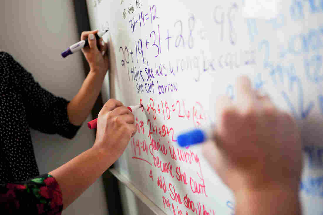 A Common Core sample problem is written on a whiteboard at NPR, in Washington, D.C.