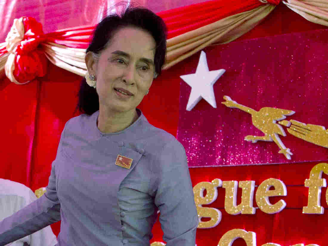 """Myanmar's opposition leader Aung San Suu Kyi says she will be """"above the president"""" if her party wins Sunday's election. In a constitutional clause that appears directed at her, a person can't become president if he or she is married to a foreign national or has children who are foreign nationals. Suu Kyi's late husband was British, as are their two sons."""