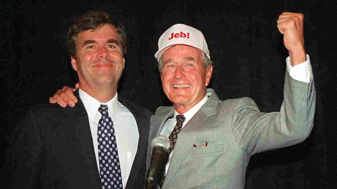 Former President George H.W. Bush pumps his fist next to his son, Jeb, during a fundraiser in Tampa, Fla., in 1994. Jeb Bush was running for governor. He lost that year, but won four years later.