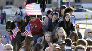 Young people attend a political rally before the recent Jefferson-Jackson dinner in Iowa. Energizing young voters may be a challenge for presidential candidates ahead of 2016.