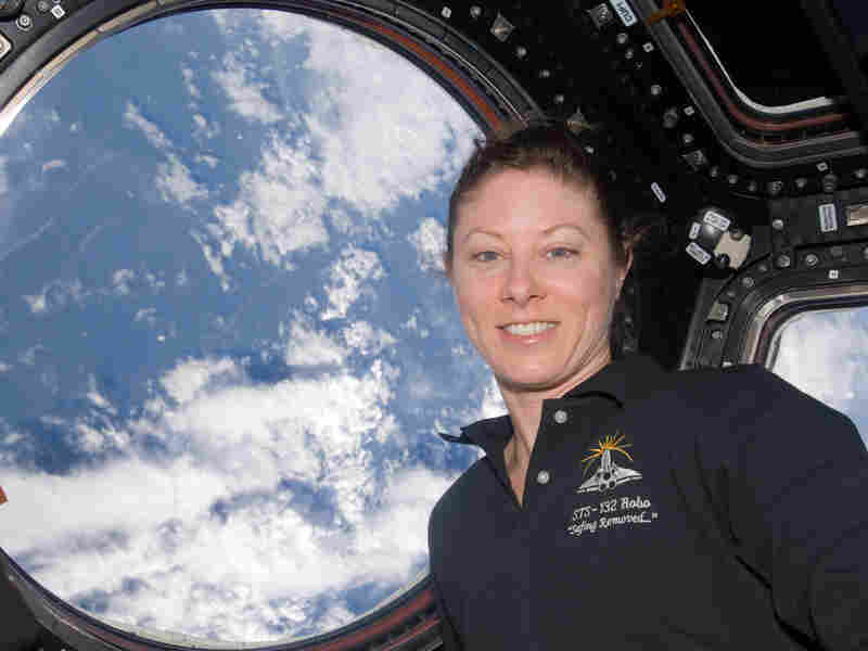 View of Tracy Caldwell Dyson, Expedition 23 Flight Engineer (FE), posing at window in the Cupola Module. Photo was taken during Expedition 23 / STS-132 Joint Operations.