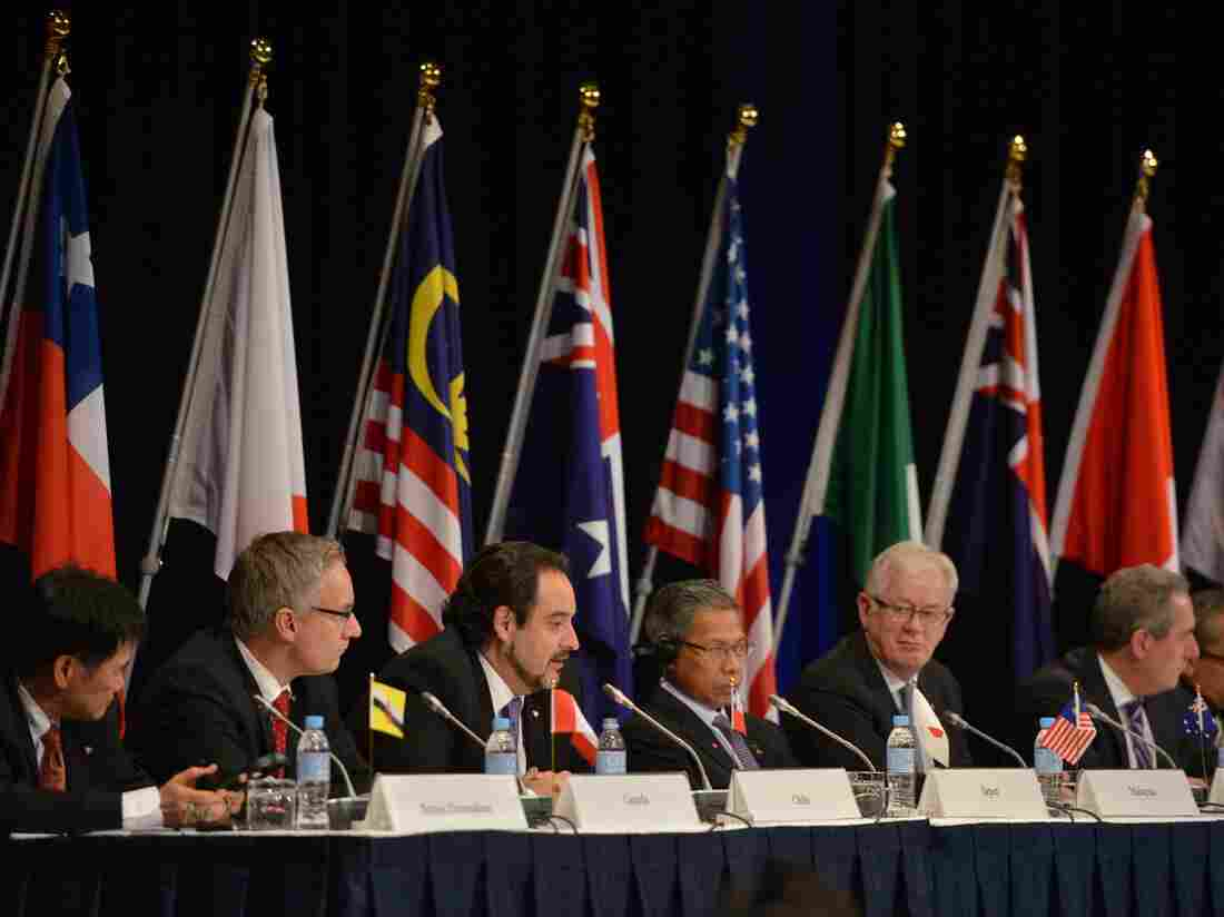 Trade representatives attend a press conference for the Trans-Pacific Partnership.