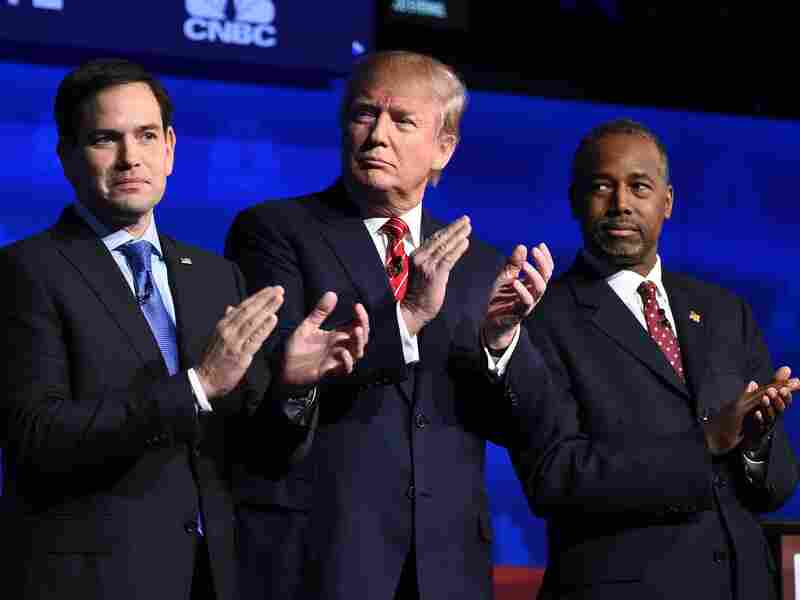 Republican presidential hopefuls Marco Rubio, Donald Trump and Ben Carson applaud as the candidates are introduced at the start of the third Republican Presidential Debate.
