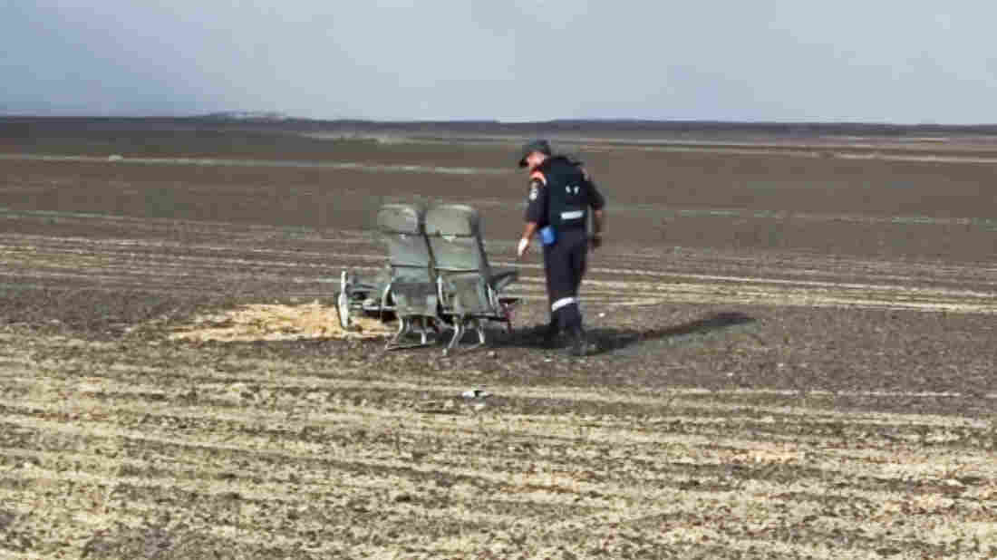 Seats from the Airbus jet that crashed in Egypt are examined by a Russian Emergency Situations Ministry employee, in this image released by the agency. Egyptian officials say they're investigating a noise heard at the end of the flight's cockpit voice recording.