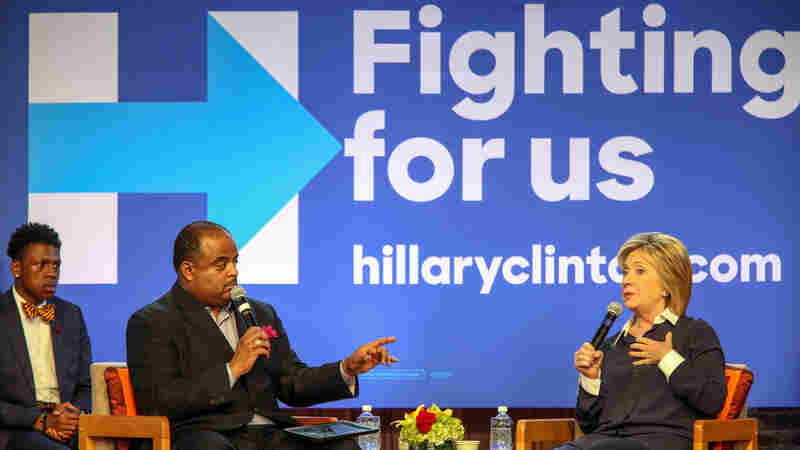 Democratic presidential candidate Hillary Clinton responds to a question from Roland Martin, host of TV One's News One Now, during a town hall meeting at Claflin University in Orangeburg, S.C.,