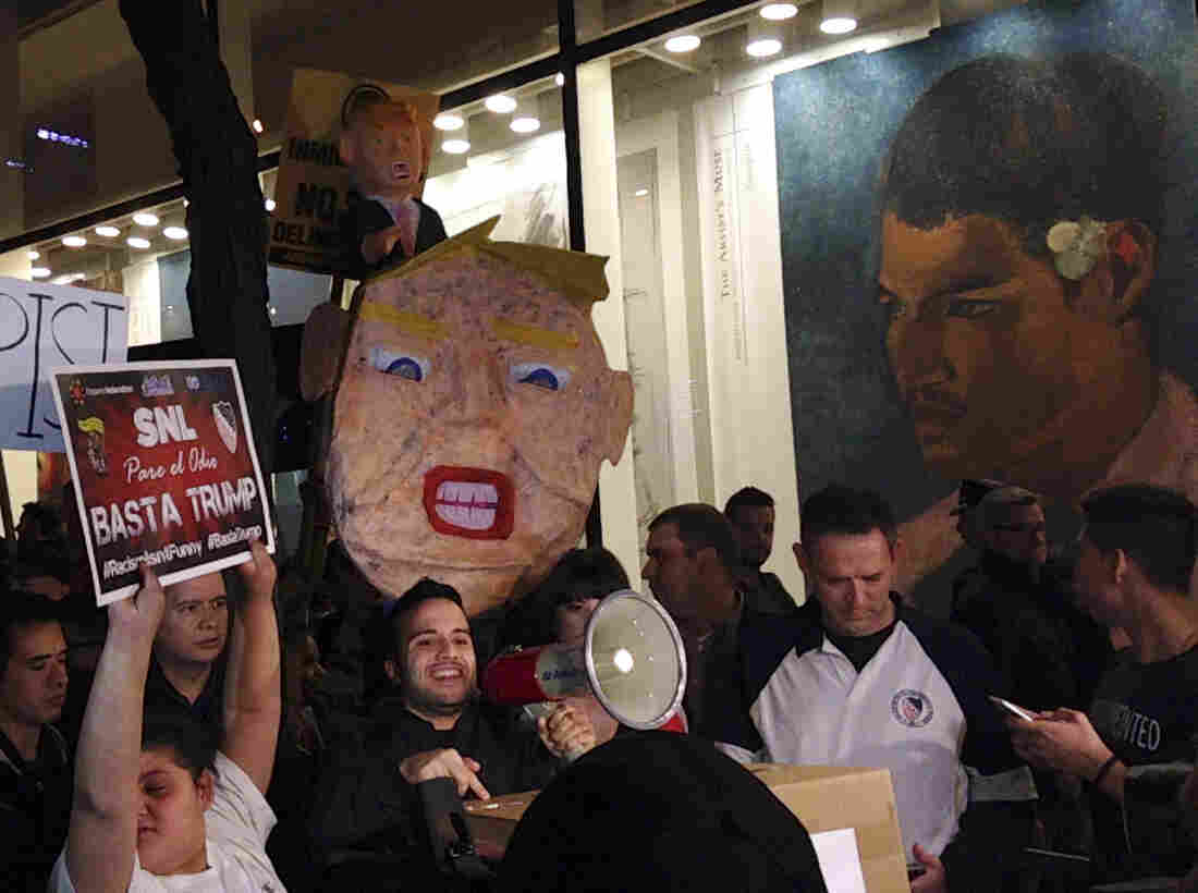 """Demonstrators march to protest Donald Trump's views on Latinos hours before he hosts """"Saturday Night Live,"""" on Saturday in New York."""