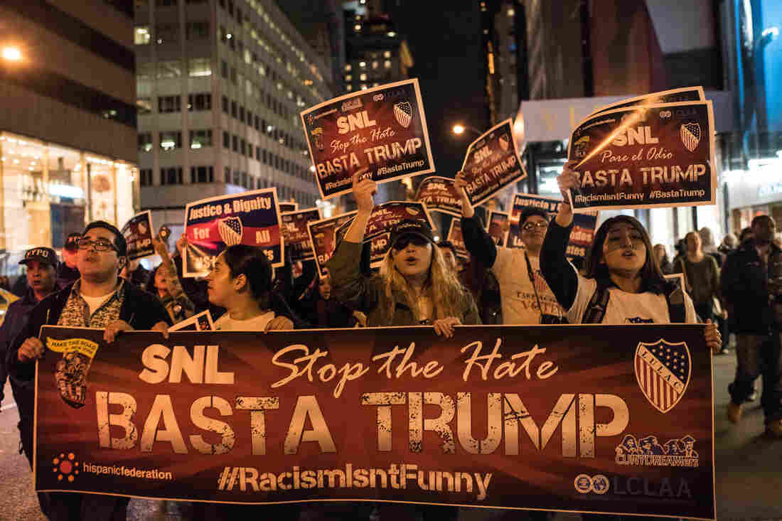 Protesters march from Trump Tower to NBC headquarters in New York City on Saturday evening, to protest Donald Trump's appearance as host of Saturday Night Live.
