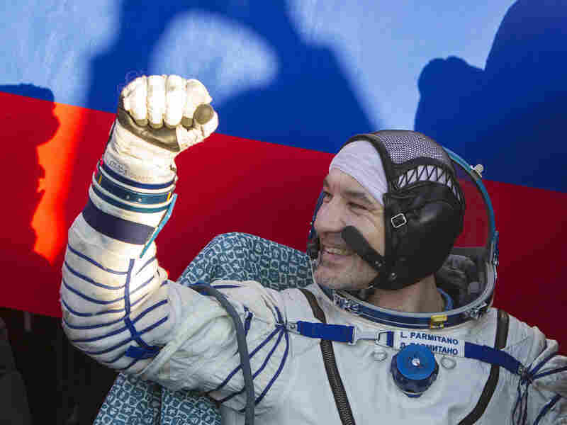 Italian astronaut Luca Parmitano gestures after landing in a remote area near the town of Zhezkazgan in central Kazakhstan on November 11, 2013.