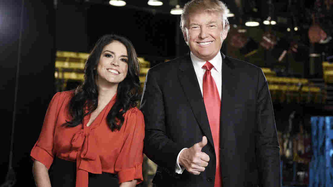 A photo provided by NBC shows, Saturday Night Live cast member Cecily Strong (left) and Republican presidential candidate Donald Trump in New York. Trump hosted the show Saturday night.