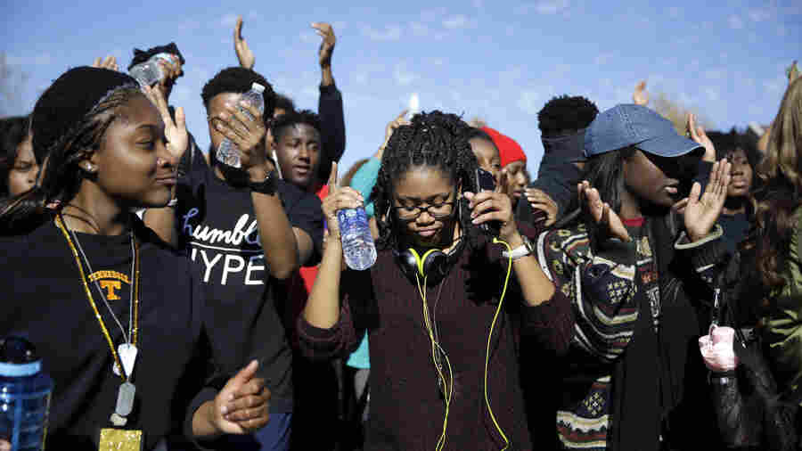 Students dance following University of Missouri System President Tim Wolfe's resignation announcement on Monday at the school in Columbia.