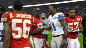 Kansas City Chiefs outside linebacker Justin Houston (second from left) shakes hands with Detroit Lions wide receiver Calvin Johnson after the NFL football game between the Lions and Chiefs at Wembley Stadium in London on Nov. 1.
