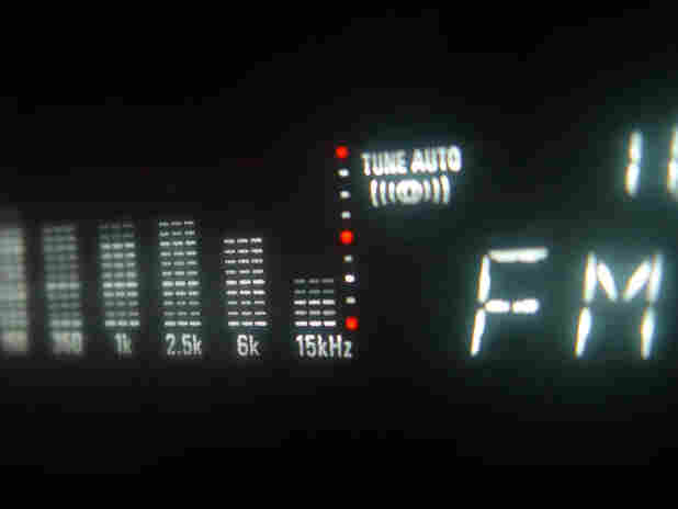 Auto tuner display shows FM signal equalizer.