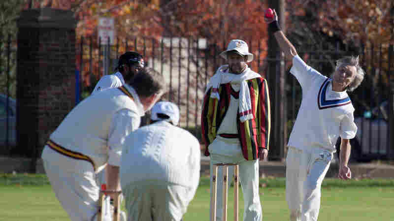 Ken Griffiths of Merion Cricket Club bowls to Richard O'Brien of Philadelphia Cricket Club, as Andrew Owens umpires.