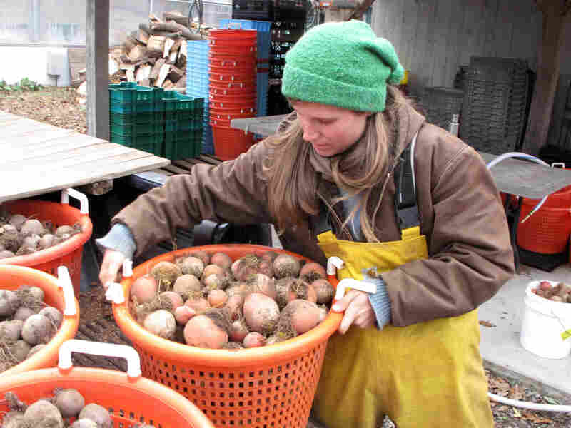 Alex Browning works at a farm in Hamilton, Mass. The 26-year-old says that unlike some of her friends who work at places with retirement plans, she knows she has to figure out how to save for herself.